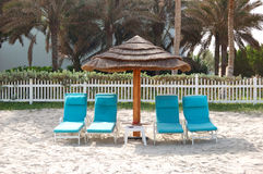 Beach and sunbeds at the luxury hotel Stock Images