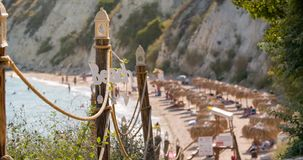 Beach with sunbeds and umbrellas. In greece stock video