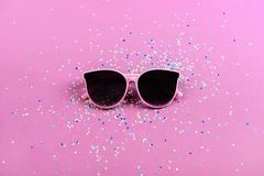Beach sunglasses summer concept on colorful background. Beach trendly sunglasses summer concept on pinkcolorful background Stock Image
