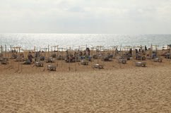 Beach with sunlovers in the Algarve Royalty Free Stock Photo