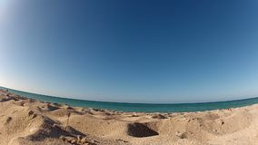 Beach at sunny day. Wide shot from the ground stock video