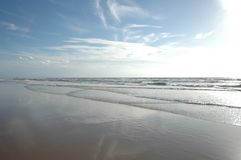 The beach with sunny sky Stock Images