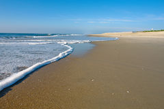 Beach at sunrise. Atlantic ocean coast, MD, USA Stock Photo