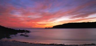 Beach sunrise. Sunrise over a bay with a red sky Stock Photo