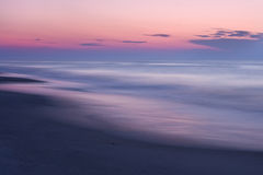 Beach Sunrise Abstract. A beautiful pastel colored sunset on a quiet, secluded beach Royalty Free Stock Photos