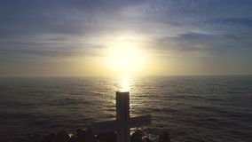 Beach sunrise and holy Christian cross of the sea horizon, faith is freedom stock video footage