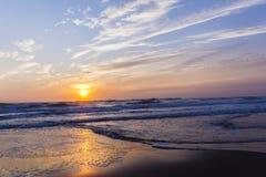 Beach Sunrise Ocean. Beach ocean waves sunrise color reflections shoreline skyline landscape Stock Image