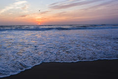 Beach Sunrise Ocean. Beach ocean waves sunrise color reflections shoreline skyline landscape Royalty Free Stock Photo