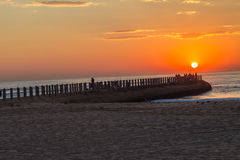 Beach Sunrise Pier Fishermen Royalty Free Stock Photo