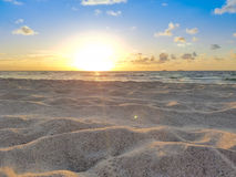 Beach Sunrise, Sun, Sand, Summer, Ocean & Blue Sky Stock Photo