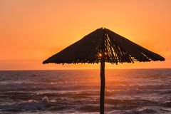 Beach Sunrise Umbrella Silhouetted Stock Image