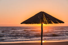Beach Sunrise Umbrella Silhouetted Stock Images