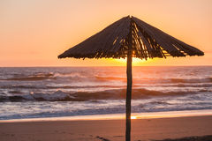 Beach Sunrise Umbrella Silhouetted Stock Photo