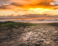 Beach sunrise walkway stock photos