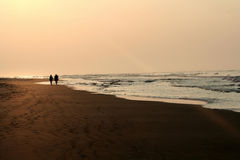 Beach at sunset. Stolling on the beach at sunset Stock Photography
