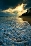 Beach at sunset Stock Photos