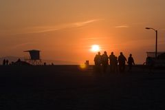 Beach sunset. A group of people enjoying sunset on the beach Stock Photography