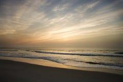 Beach at sunset. Stock Photos