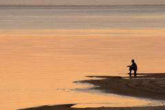 Beach sunset. Scene in Mozambique with fisherman Royalty Free Stock Photography