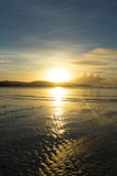Beach Sunset. A sunset with the sun reflecting off the beach and ocean stock photo