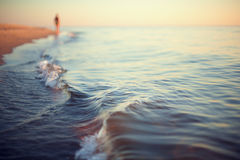 Beach sunset abstract background shoreline. Close up stock photography