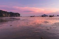 Beach and sunset at Ao Nang beach, Krabi, Thailand with traditio Royalty Free Stock Image