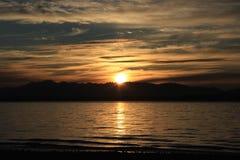 Beach Sunset. A blue, orange, and gold cloudy beach sunset Stock Photography