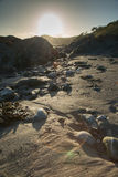 Beach at sunset in Cornwall, England stock photo