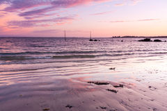 Beach at sunset Stock Image