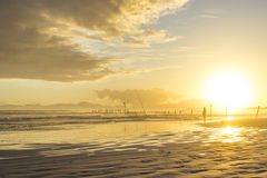 Beach sunset with fisherman silhouette - Western Cape, South Africa. Stock Photo