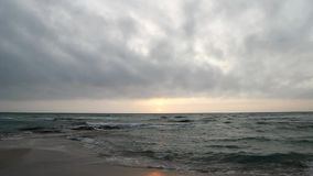 Beach at sunset at Gallipoli with the rough sea - Italy stock footage