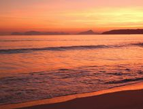 Beach at sunset with golden light and islands.Galicia.Spain.Europe. royalty free stock image
