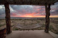 Beach Sunset with Hammock. Vivid sunset overlooking beach in Baja Mexico Royalty Free Stock Photos