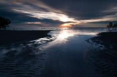 Beach during sunset stock photos