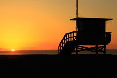Beach sunset. Life guard station watching over a sunset Royalty Free Stock Photo