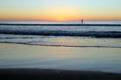 Beach Sunset with Paddler Stock Photography