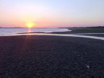 Beach Sunset. Pebble beach at sunset Stock Photography