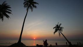 Beach at sunset at Phu Quoc island, Kien Giang province, Vietnam. Sunset,  Phu Quoc island, Kien Giang province, Vietnam. Phu Quoc is blessed with favourable stock footage
