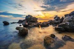 Beach at sunset Stock Image