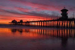 Beach sunset and pier Royalty Free Stock Photos