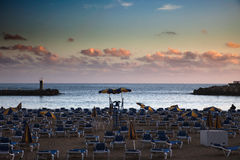 Beach at sunset, Puerto Rico, Gran Canaria. Scenic view of tourist beach of Puerto Rico on island of Gran Canaria Stock Photo