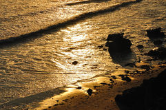 Beach at sunset in Big Sur. Beach at sunset with reflection of the sun on water in Big Sur, California, USA Stock Photography