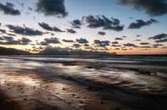 Beach at sunset Royalty Free Stock Photos