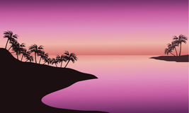 Beach at sunset silhouette. With pink backgrounds Royalty Free Stock Photos