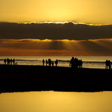 Beach sunset silhouettes Stock Image
