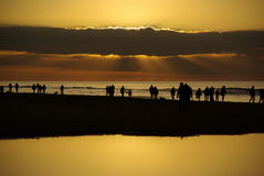 Beach sunset silhouettes Royalty Free Stock Image