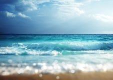 Beach in sunset time, tilt shift soft effect. Seychelles islands Royalty Free Stock Image