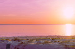 Beach at sunset in Ventspils Royalty Free Stock Images