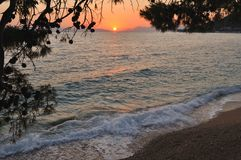 Beach at sunset. Podgora, Croatia Royalty Free Stock Images