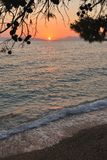 Beach at sunset. Podgora, Croatia Royalty Free Stock Photos
